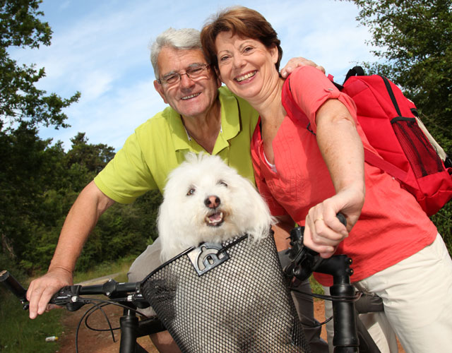 Biking with dog at Hoosier Village dog-friendly community