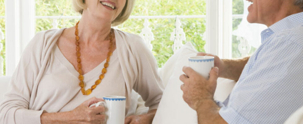 mature-couple-having-coffee-700×600