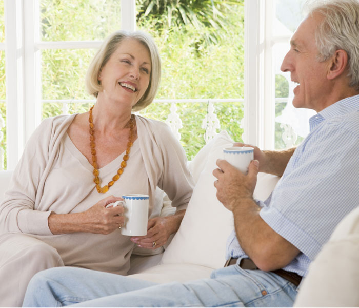 mature-couple-having-coffee-700x600