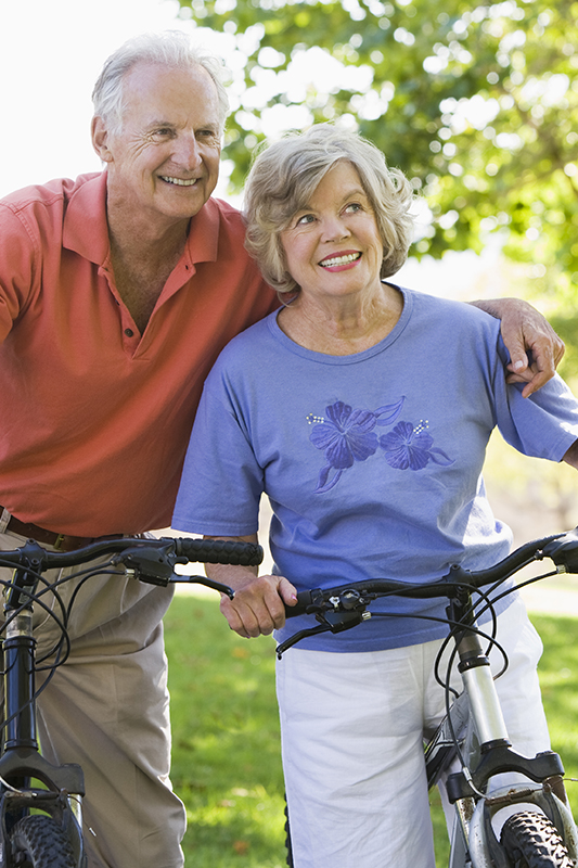 A couple riding their bicycles