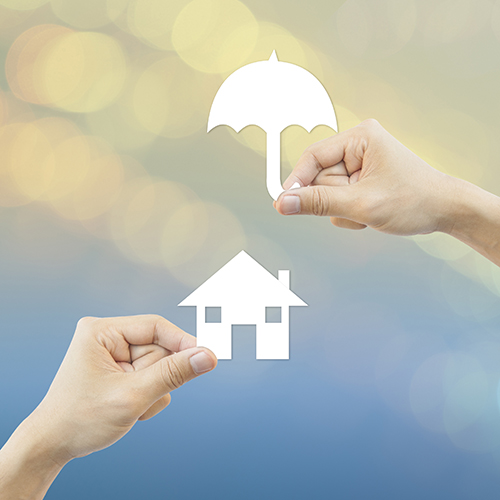 Business concept Hand hold white paper house and umbrella bokeh